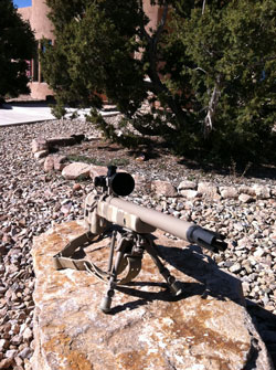 Sniper rifle with scope.